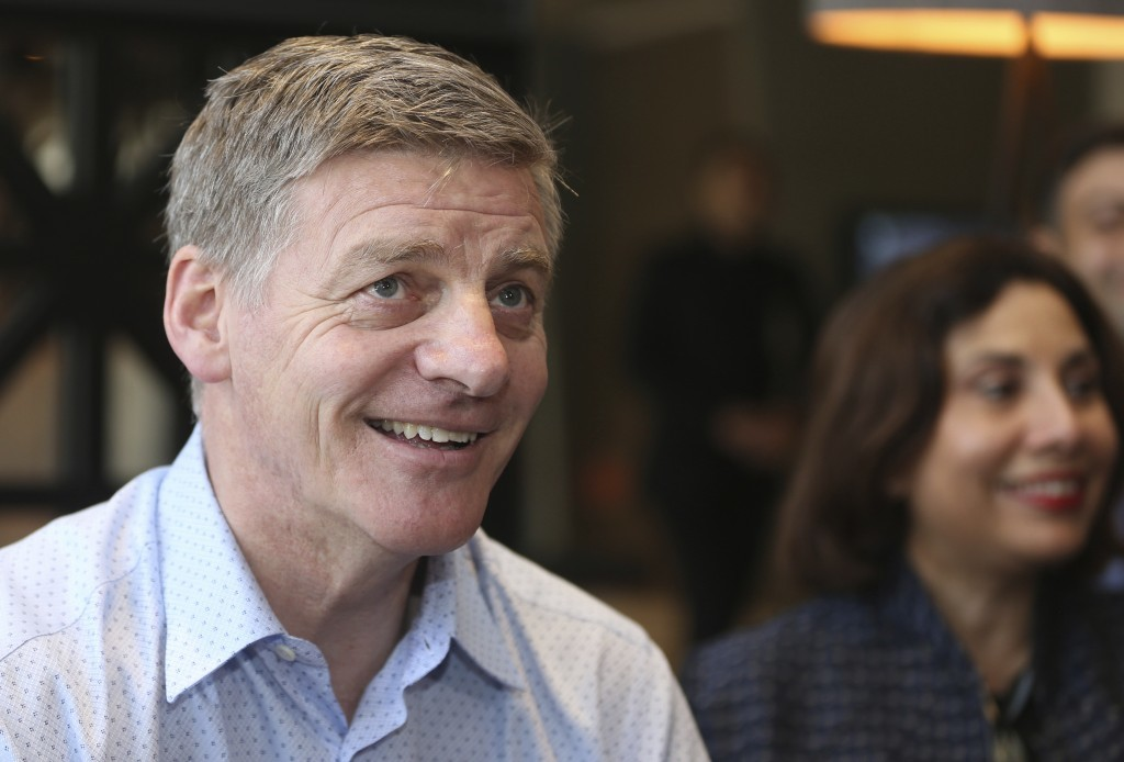 New Zealand Prime Minister Bill English talks to the media at his hotel in Auckland, New Zealand, Saturday, Sept. 23, 2017. New Zealanders were voting...