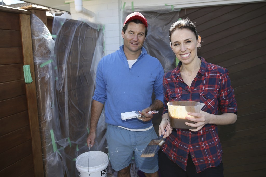 New Zealand Labour Party leader Jacinda Ardern and her partner Clarke Gayford paint their fence at home in Auckland, New Zealand, Saturday, Sept. 23, ...