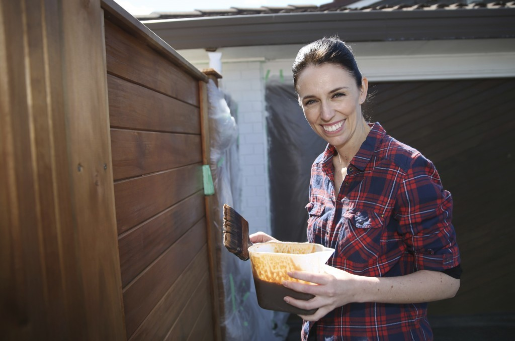 New Zealand Labour Party leader Jacinda Ardern paints her fence at home in Auckland, New Zealand, Saturday, Sept. 23, 2017. New Zealanders were voting...