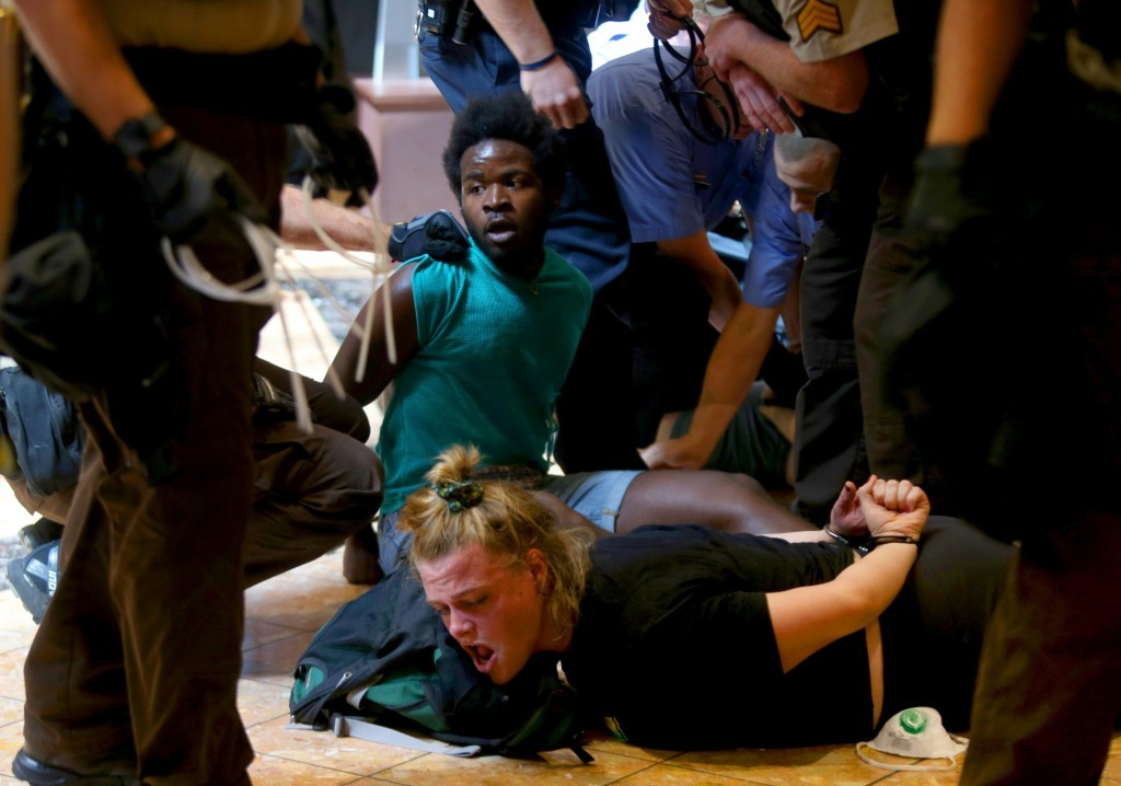 Protesters are bound after being arrested at the St. Louis Galleria mall in Richmond Heights, after several hundred people demonstrated in protest ove...