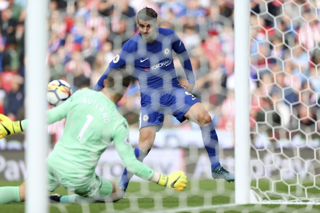 Chelsea's Alvaro Morata scores his side's third goal of the game during the English Premier League soccer match between Stoke City and Chelsea at the ...