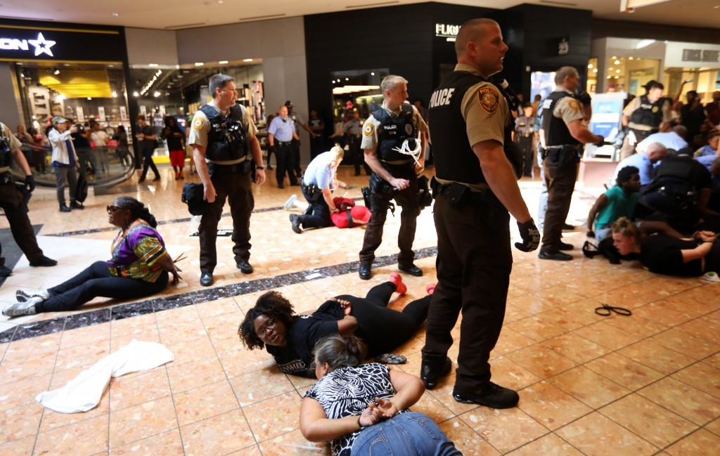 Protesters are arrested at the St. Louis Galleria mall in Richmond Heights, Mo., after several hundred people demonstrated in protest over the recent ...