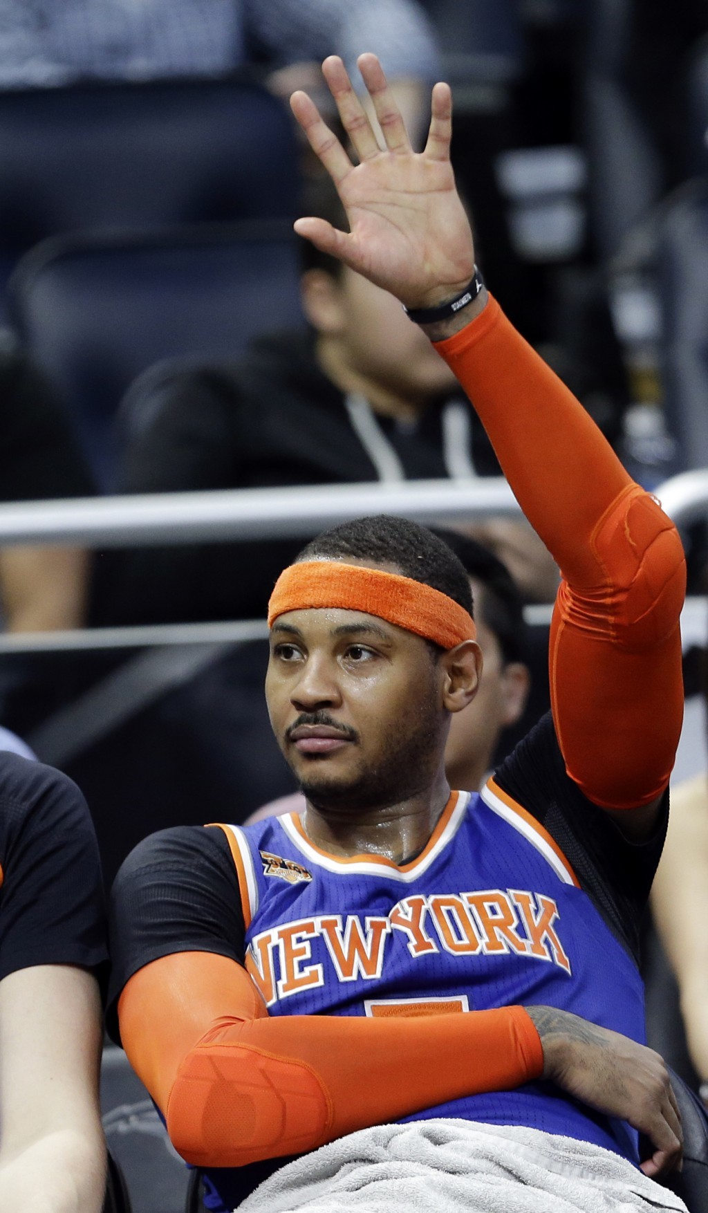 FILE - In this March 1, 2017, file photo New York Knicks' Carmelo Anthony waves to fans cheering his name during the final moments of an NBA basketbal...
