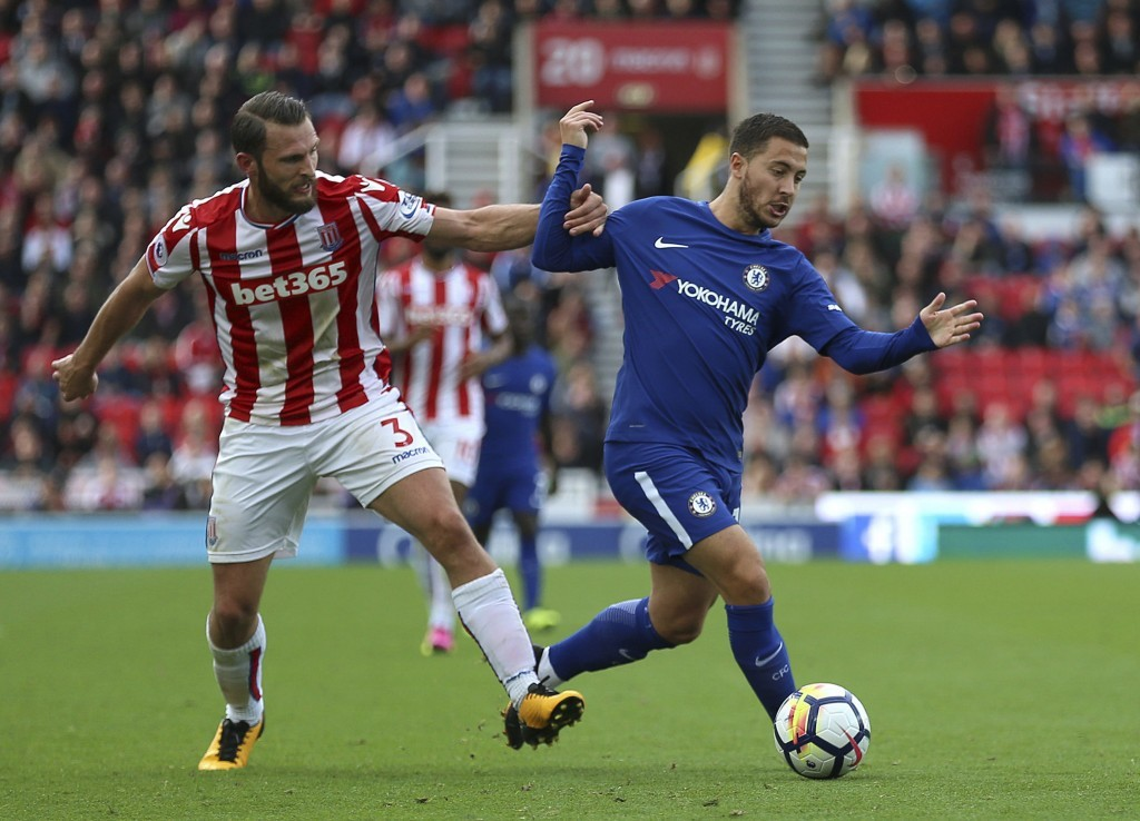 Chelsea's Eden Hazard, right, and Stoke City's Erik Pieters battle for the ball during the English Premier League soccer match between Stoke City and ...