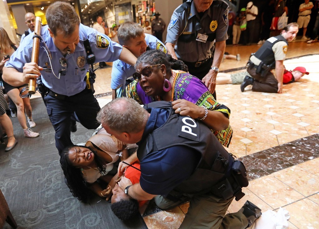 In a Saturday, Sept. 23, 2017 photo, police make several arrests of people protesting the Sept. 15 acquittal of former police officer Jason Stockley i...