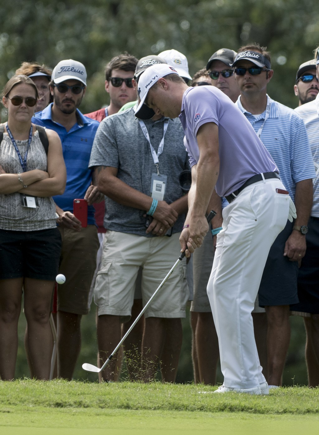 Justin Thomas chips to the first green during the final round of the Tour Championship golf tournament at East Lake Golf Club in Atlanta, Sunday, Sept...