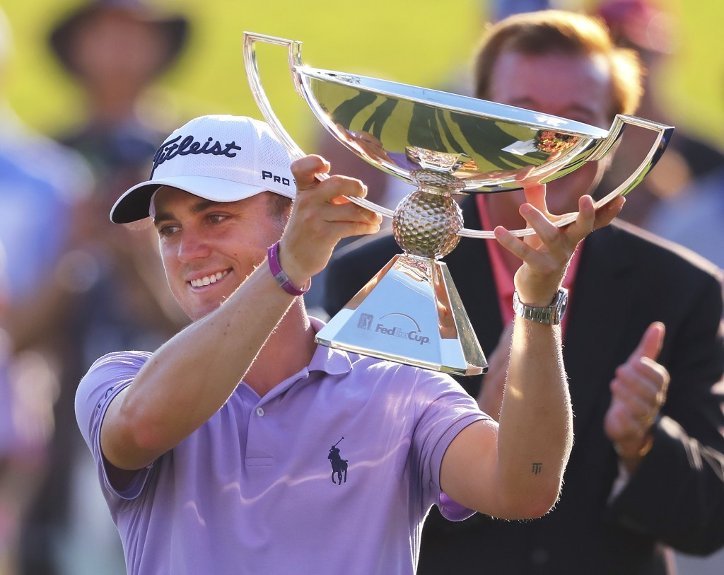 Justin Thomas holds the trophy after winning the Fedex Cup after the Tour Championship golf tournament at East Lake Golf Club in Atlanta, Sunday, Sept...