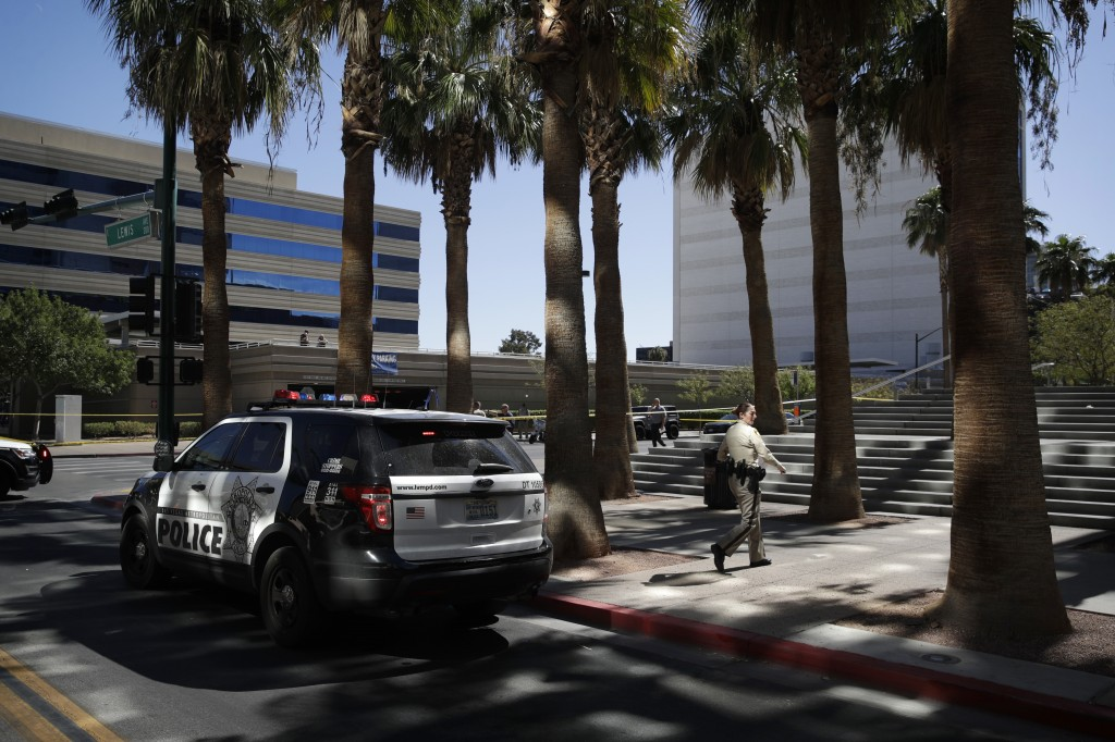Police investigate a crime scene in front of the Regional Justice Center court house, Monday, Sept. 25, 2017, in Las Vegas. Police say a woman was str