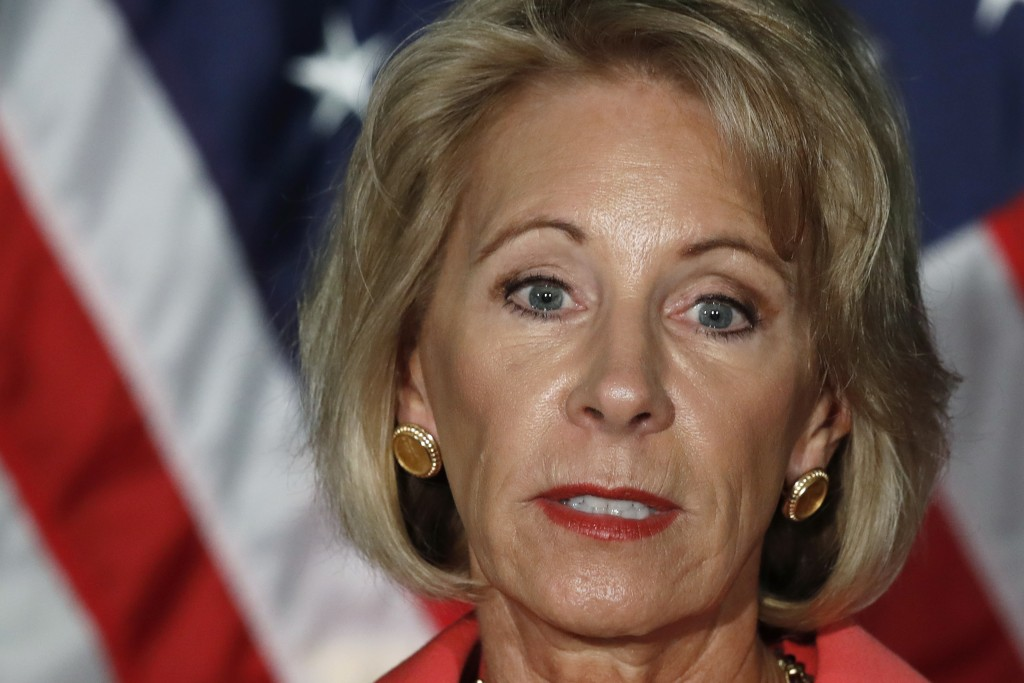 FILE - In this Sept. 7, 2017 photo, Education Secretary Betsy DeVos speaks at George Mason University Arlington, Va., campus. Low-income students in F...