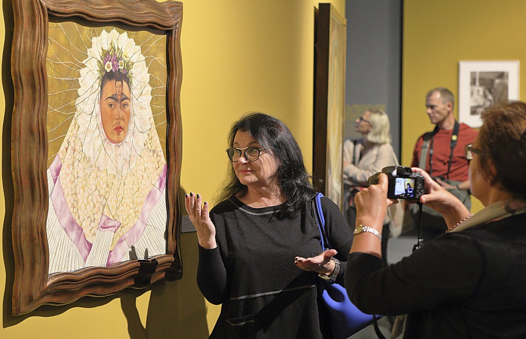 """Guests attend a preview of a new exhibition on Mexican artists Frida Kahlo and Diego Rivera in Poznan, Poland, on Tuesday Sept. 26, 2017. """"Frida Kahlo..."""