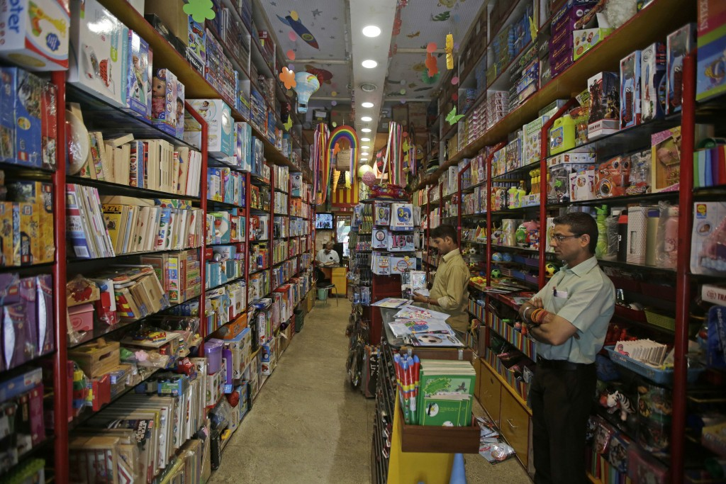 FILE - In this June 15, 2017, file photo, employees wait for customers at a toy shop in Khan Market, New Delhi, India. Three years later Prime Ministe...