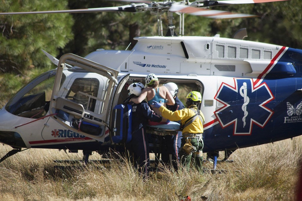 In this Wednesday, Sept. 27, 2017, photo provided by Dakota Snider, photographer and Yosemite resident, a woman is carried into a helicopter after bei...