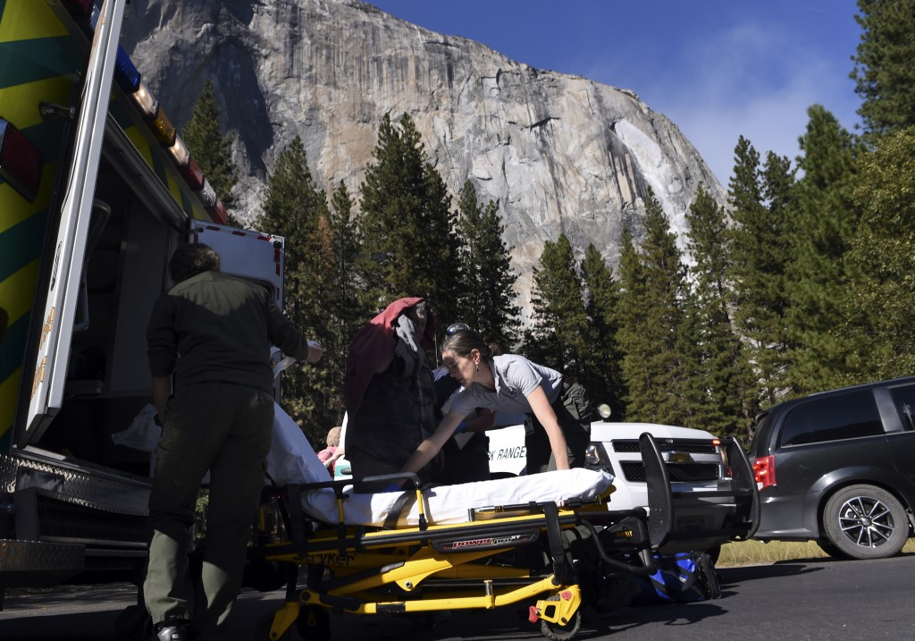 Emergency personnel prepare to care for an elderly male, center background, after a rock fall occurred again on El Capitan Thursday afternoon, Sept. 2...