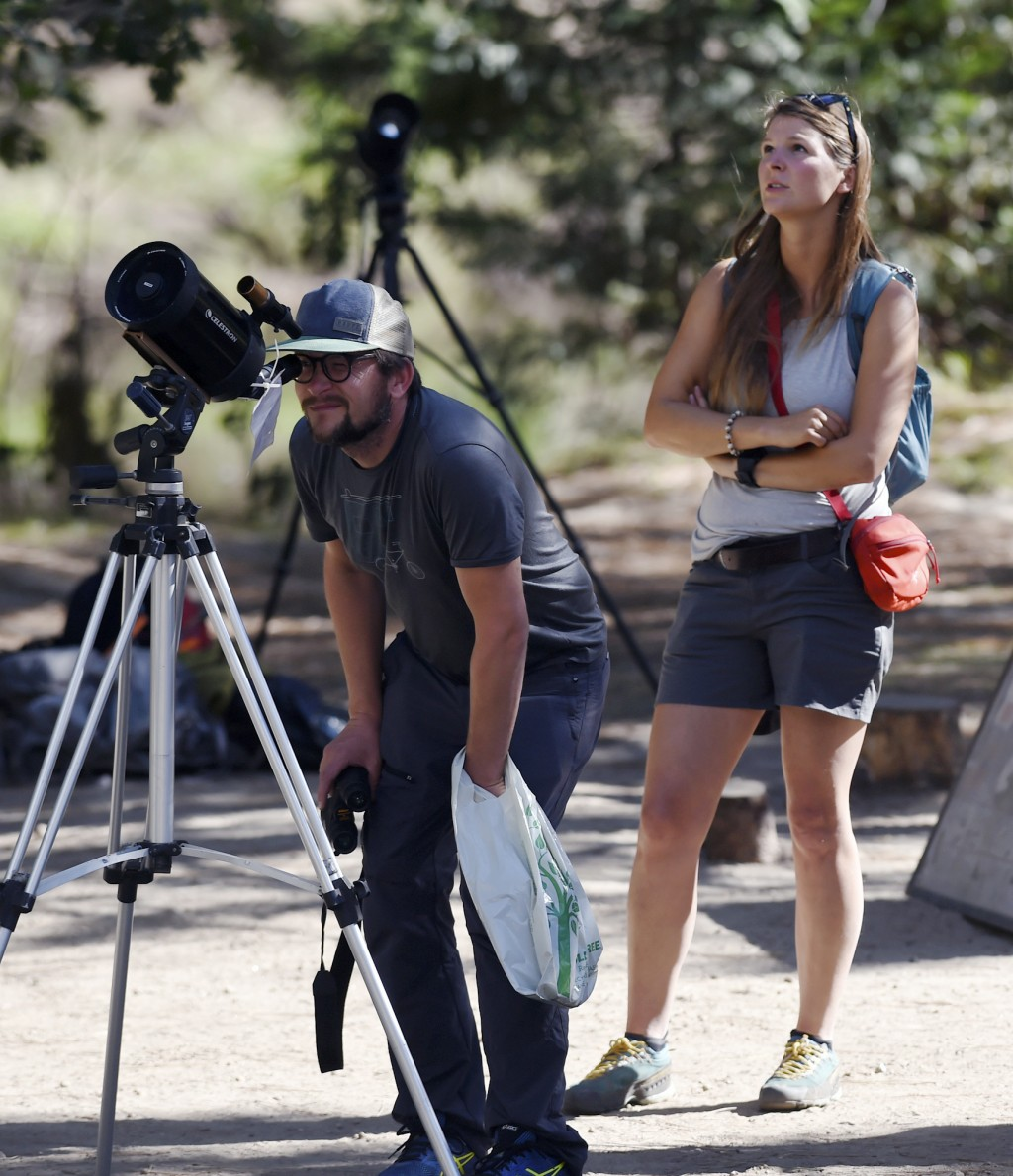 Visitors watch the rock fall from El Capitan Meadow Thursday, Sept. 28, 2017, in Yosemite National Park, Calif. Yosemite National Park says another ro...