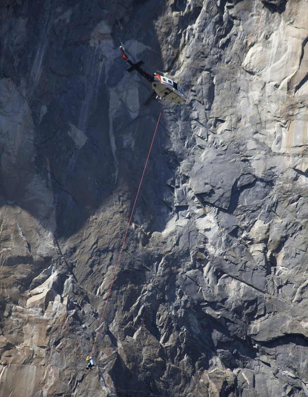 In this Wednesday Sept. 27, 2017, photo provided by Dakota Snider, photographer and Yosemite resident, a helicopter makes a rescue off El Capitan afte...