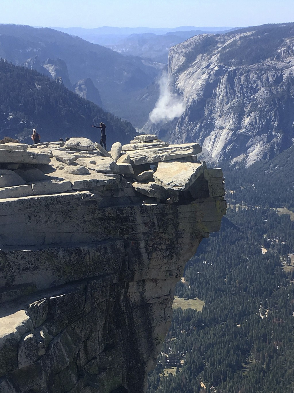 In this Wednesday Sept. 27, 2017, photo provided John P. DeGrazio, a cloud of dust is seen in the distance on El Capitan after a major rock fall in Yo...