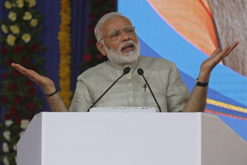 FILE - In this  June 30, 2017, file photo, Indian Prime Minister Narendra Modi speaks at an event a day before the implementation of the nationwide Go...