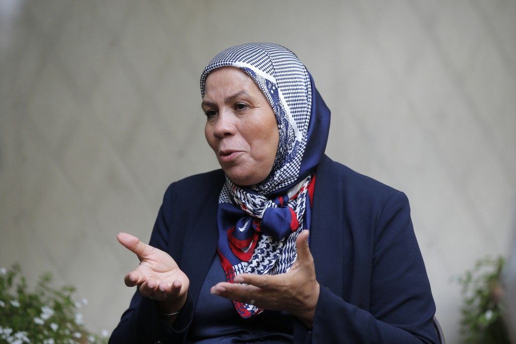 Latifa Ibn Ziaten, mother of Mohammed Merah's first victim, answers the Associated Press in Paris, Friday, Sept. 29, 2017. Soon after Mohammed Merah's...