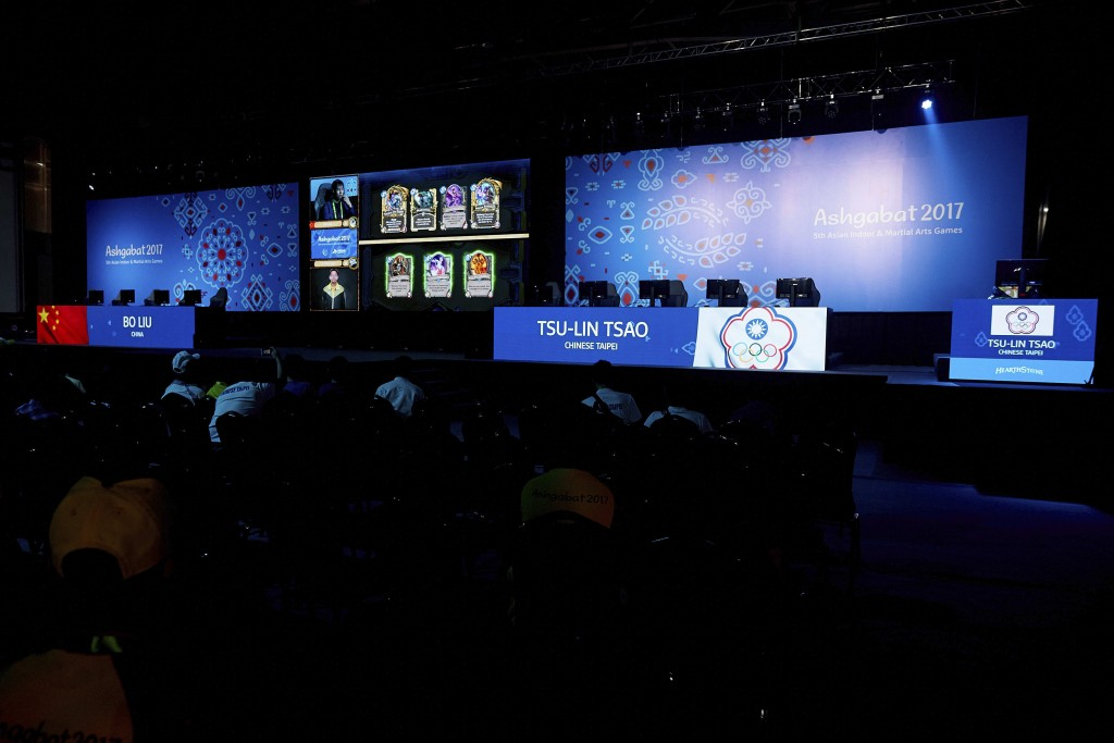 """In this photo taken by LAUREL Photo Services on Tuesday, Sept. 26, 2017, esports competitors play the card game """"Hearthstone"""" at the Asian Indoor and ..."""