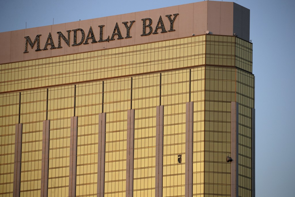 Drapes billow out of broken windows at the Mandalay Bay resort and casino Monday, Oct. 2, 2017, on the Las Vegas Strip following a deadly shooting at ...