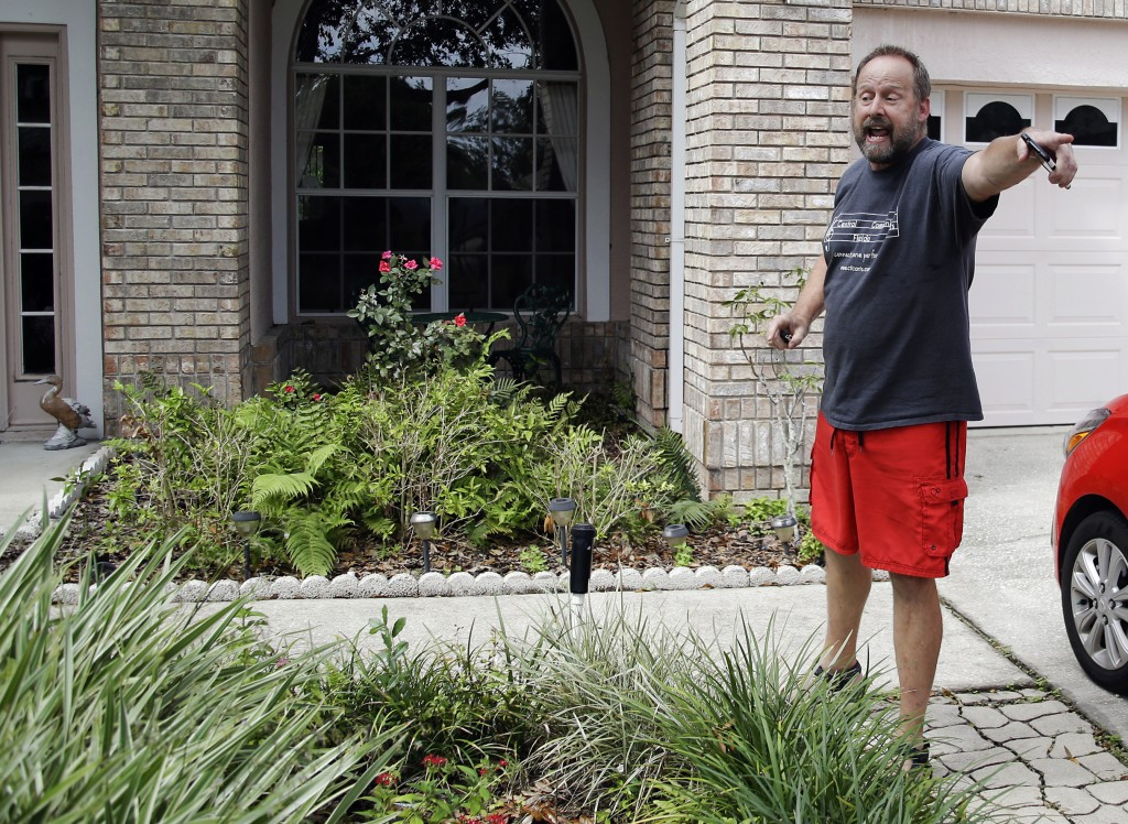 Eric Paddock, brother of Las Vegas gunman Stephen Paddock, orders a television reporter off his property at his home, Monday, Oct. 2, 2017, in Orlando...