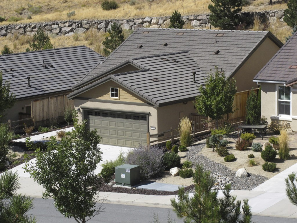 This photo shows a home that FBI agents searched Monday, Oct. 2, 2017, in Reno, Nev. The home was owned by Stephen Paddock, who opened fire on a crowd...