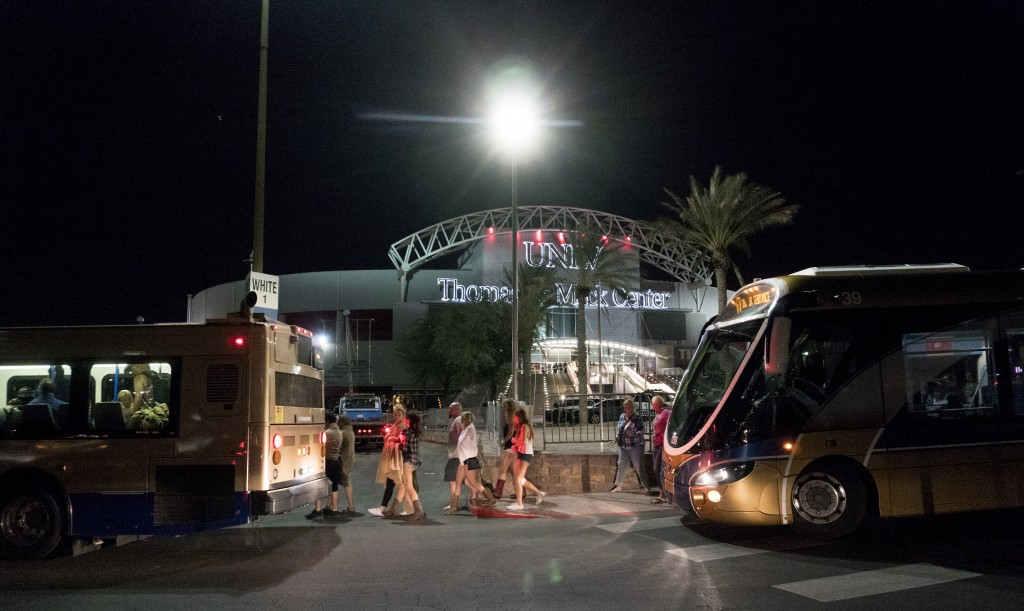 People load into buses destined to different Strip Casinos following a mass shooting at the Route 91 music festival along the Las Vegas Strip, Monday,...