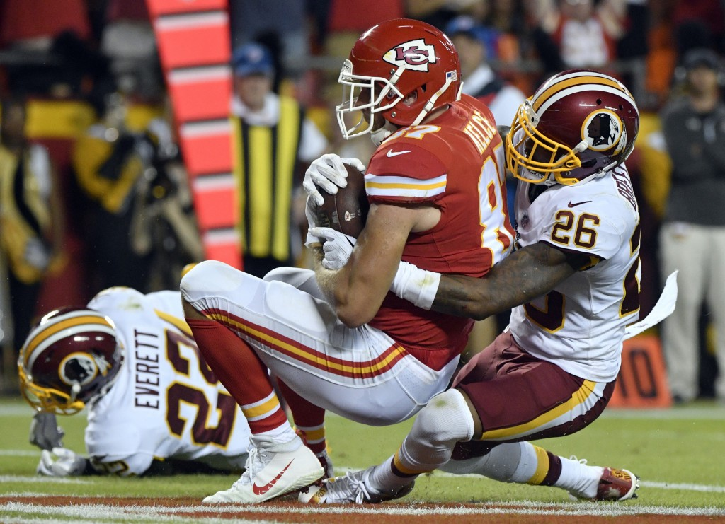 Kansas City Chiefs tight end Travis Kelce (87) makes a touchdown catch as Washington Redskins cornerback Bashaud Breeland (26) defends during the firs...