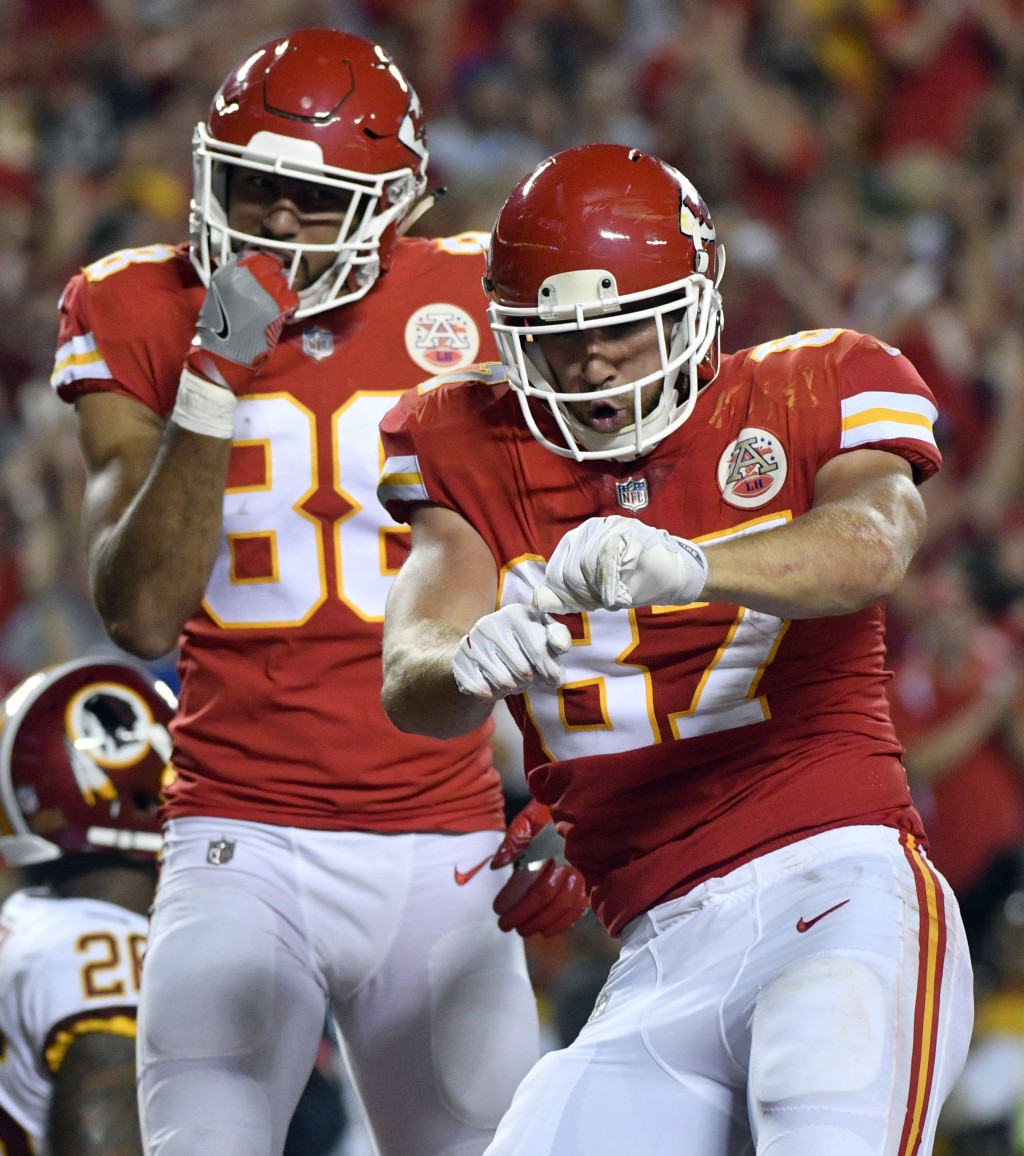 Kansas City Chiefs tight end Travis Kelce (87) celebrates his touchdown in front of teammate Ross Travis (88) during the first half of an NFL football...