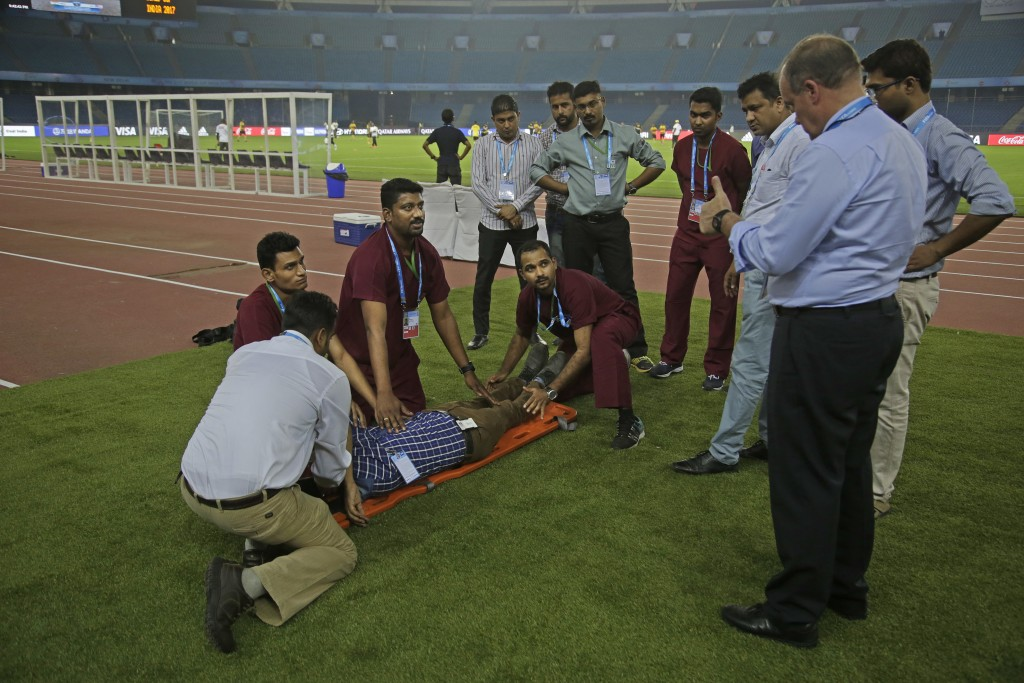 Paramedics undergo a mock drill to evacuate injured at Jawaharlal Nehru Stadium, one of the venues for the FIFA U-17 World Cup in New Delhi, India, We...