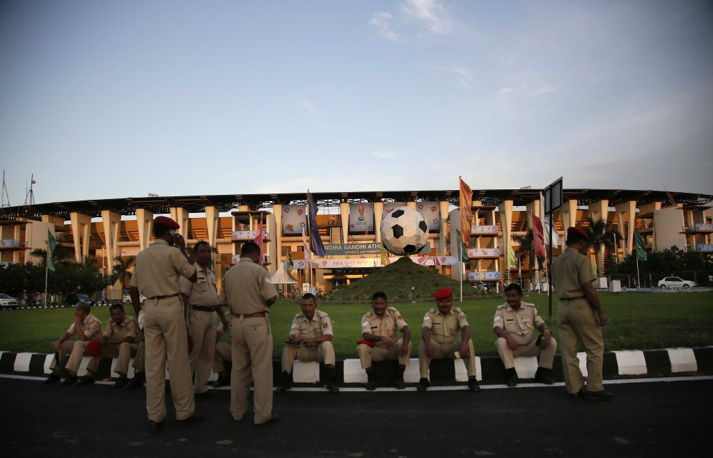 Security officers rest outside Indira Gandhi Athletic Stadium, one of the venues for the FIFA U-17 World Cup football, in Gauhati, India, Thursday, Oc...