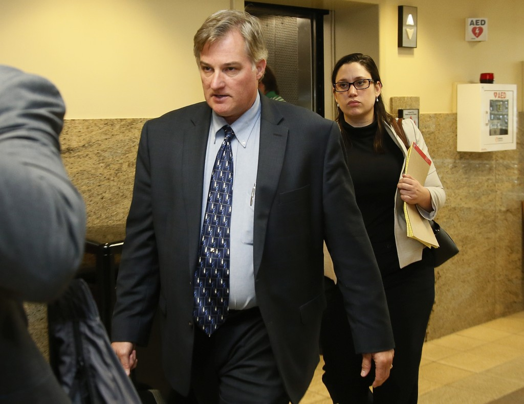 FILE - In this Friday, June 30, 2017 file photo, ex-Tulsa police officer Shannon Kepler, left, arrives with his legal team for afternoon testimony in ...