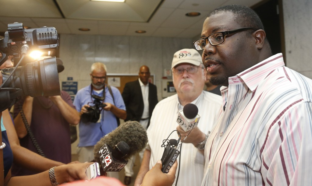FILE - In this Monday, July 13, 2015 file photo, Marq Lewis, of We The People, speaks with the media in Tulsa, Okla., Monday, July 13, 2015. Tulsa act...