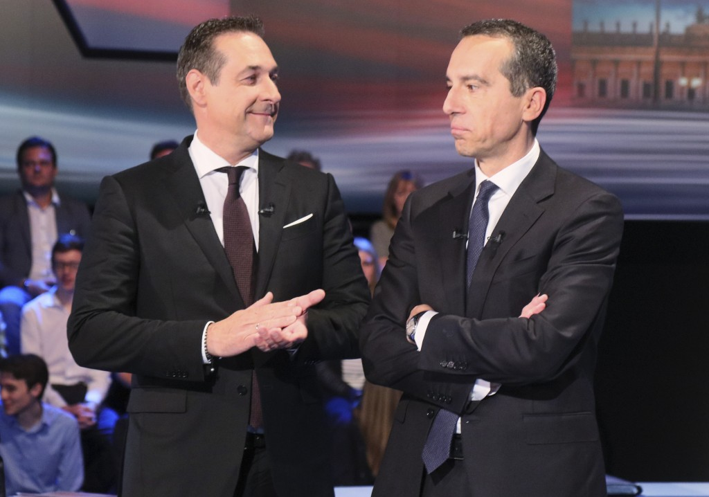 Hans-Christian Strache, leader of the strongly eurosceptic Austrian Freedom Party, left, looks to Austrian Chancellor Christian Kern prior to a TV deb...