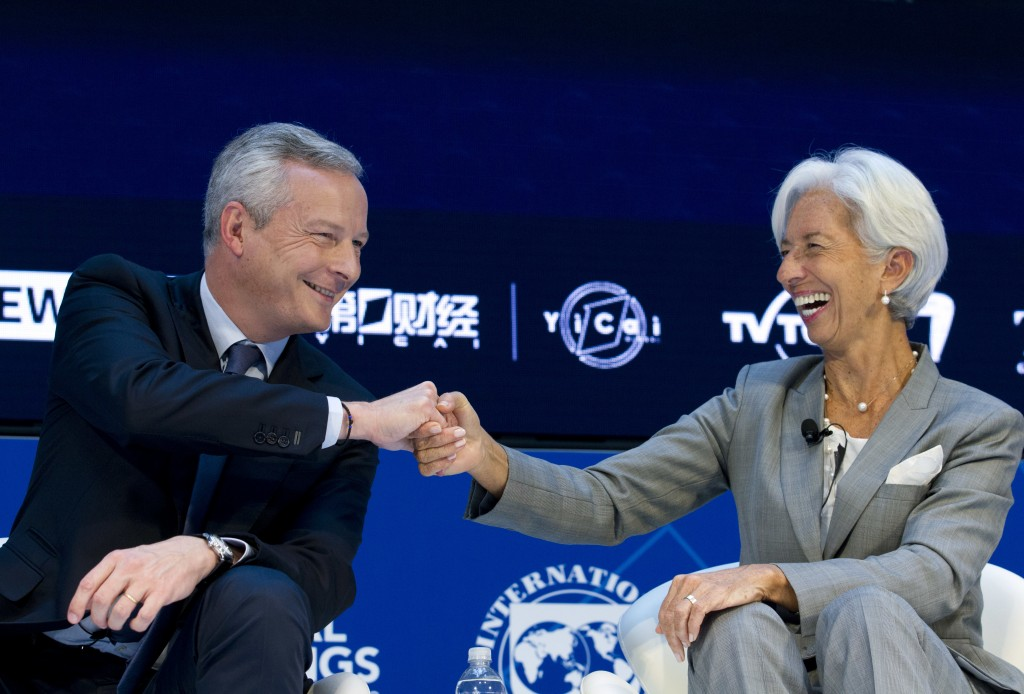 French Finance Minister Bruno Le Maire shake hands with International Monetary Fund (IMF) Managing Director Christine Lagarde during Global Economy de