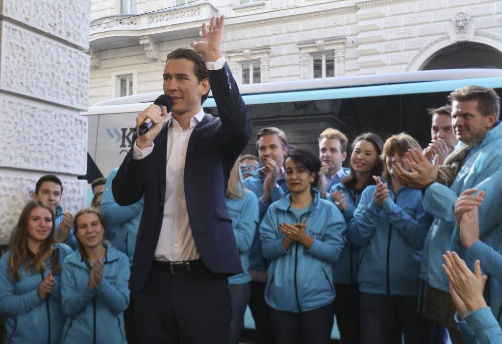 Foreign Minister Sebastian Kurz, head of Austrian People's Party, waves during a brief campaign rally in Vienna, Austria, Friday, Oct. 13, 2017. Austr...