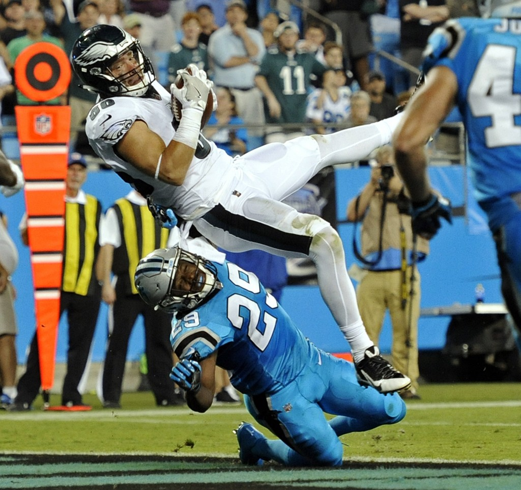 Philadelphia Eagles' Zach Ertz (86) catches a touchdown pass as Carolina Panthers' Mike Adams (29) defends in the second half of an NFL football game