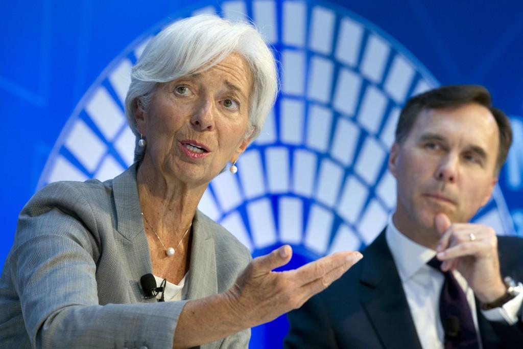 International Monetary Fund (IMF) Managing Director Christine Lagarde accompanied by Canada Finance Minister William Morneau, speaks during a Global E