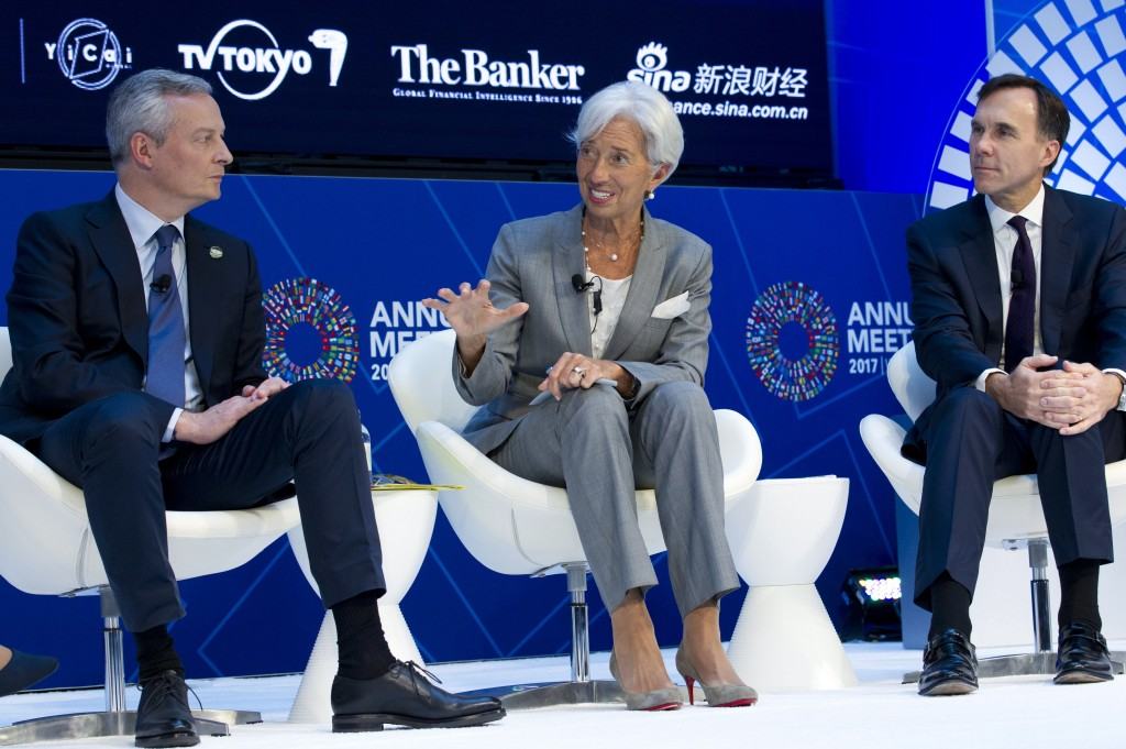 International Monetary Fund (IMF) Managing Director Christine Lagarde accompanied by French Finance Minister Bruno Le Maire, left, and Canada's Financ
