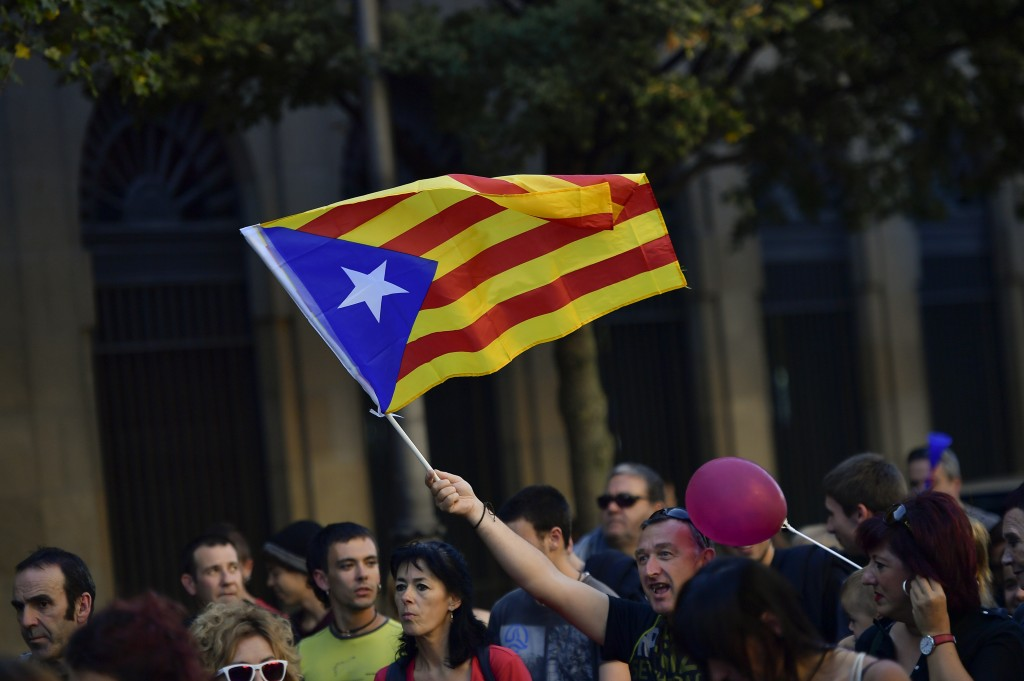 A pro independence supporter holds up an ''estelada'' or Catalan pro independence flag during a rally in support of the Catalonia's secession from Spa