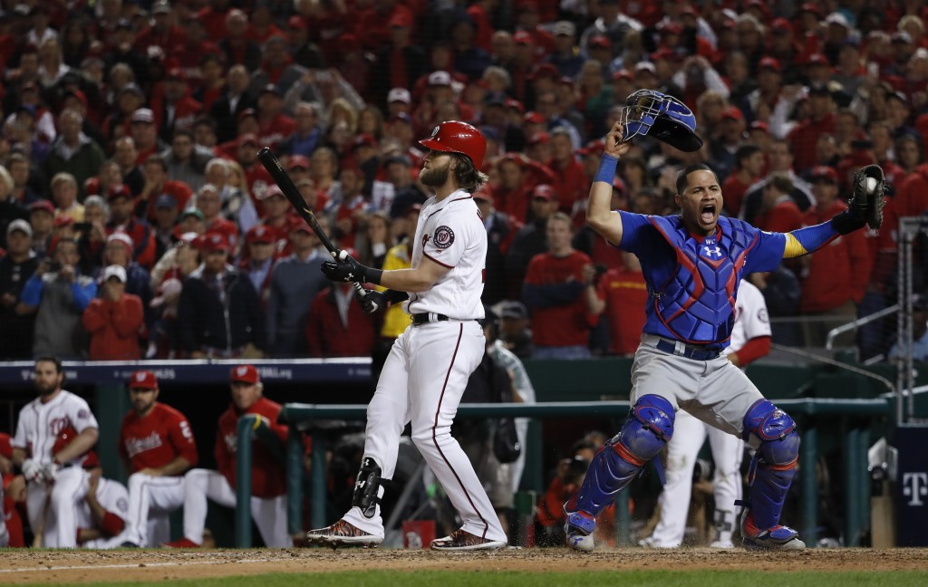 Chicago Cubs catcher Willson Contreras begins to celebrate after Washington Nationals' Bryce Harper struck out swinging in the ninth inning to end Gam