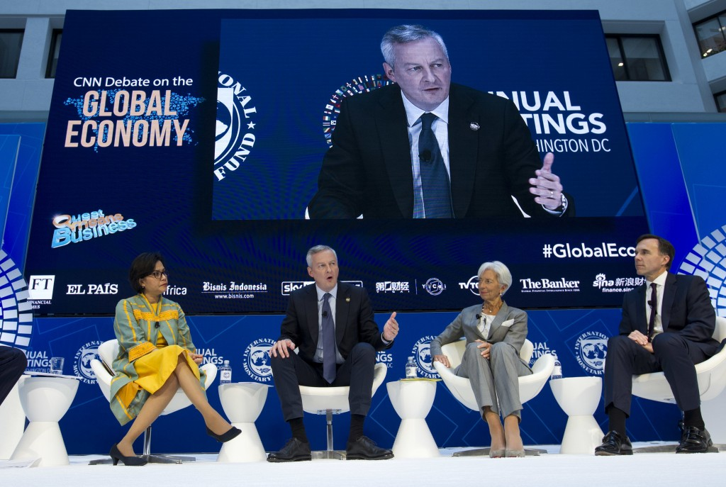 French Economy Minister Bruno Le Maire speaks during an Global Economy debate accompanied from left, Indonesian Finance Minister Sri Mulyani Indrawati