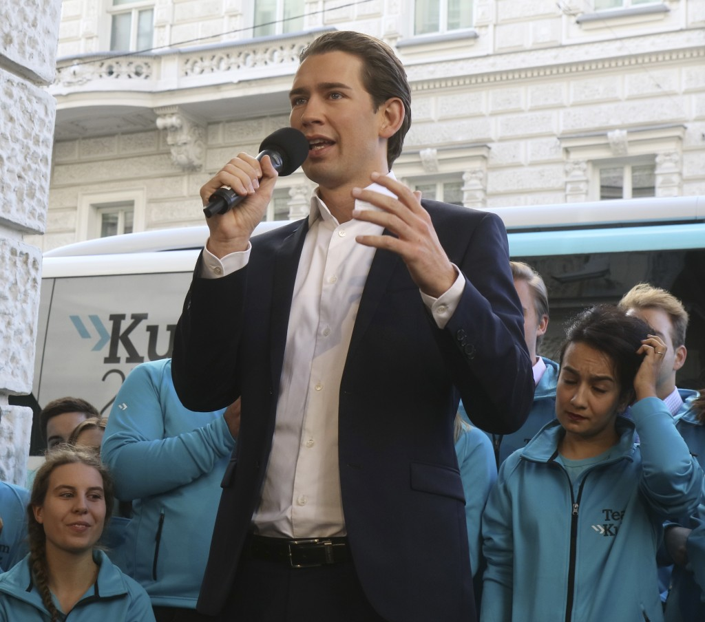 Foreign Minister Sebastian Kurz, head of Austrian People's Party, speaks during a brief campaign rally in Vienna, Austria, Friday, Oct. 13, 2017. Aust...