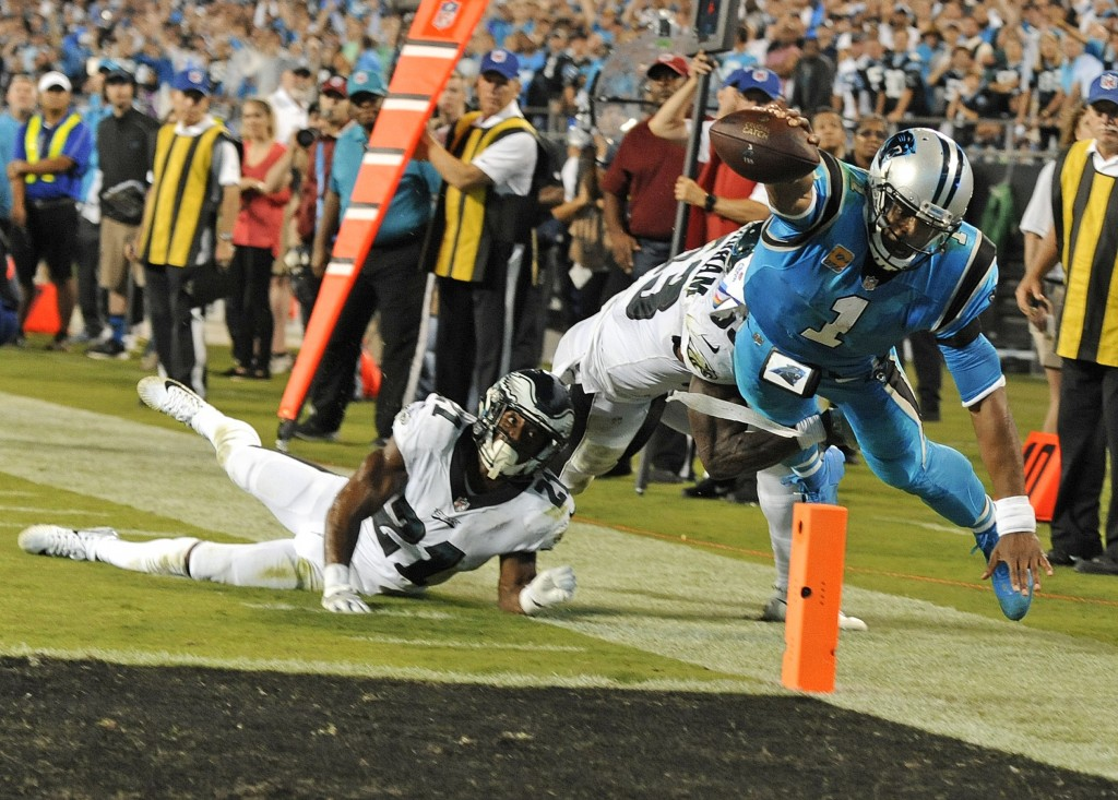 Carolina Panthers' Cam Newton (1) dives for the end zone as Philadelphia Eagles' Patrick Robinson (21) and Rodney McLeod (23) defend in the second hal