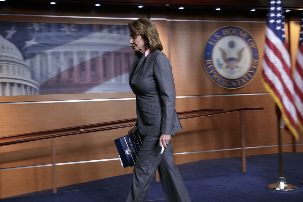 House Minority Leader Nancy Pelosi, D-Calif., departs a news conference on Capitol Hill in Washington after responding to President Donald Trump's exe...