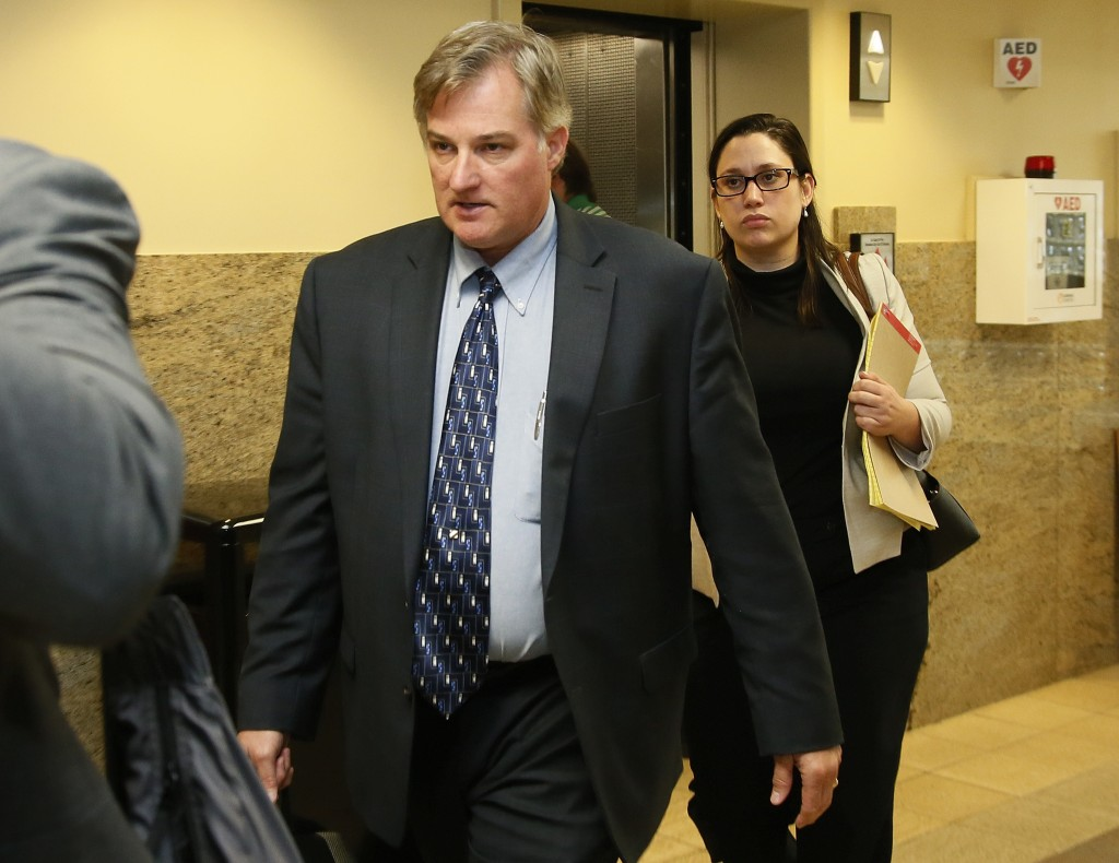 FILE - In this June 30, 2017 file photo, ex-Tulsa police officer Shannon Kepler, left, arrives with his legal team for afternoon testimony in his thir...