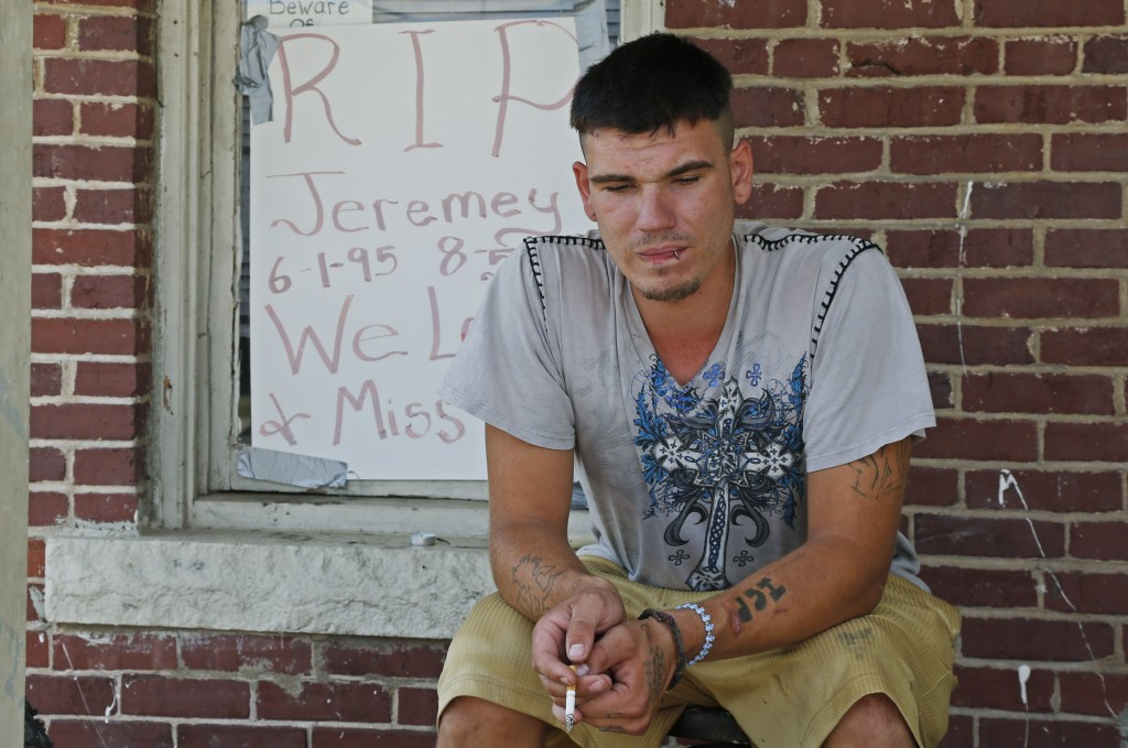 FILE - In this Friday, Aug. 15, 2014 photo, Josh Mills sits on the porch near where Jeremey Lake was killed in Tulsa, Okla. Former Tulsa police office...