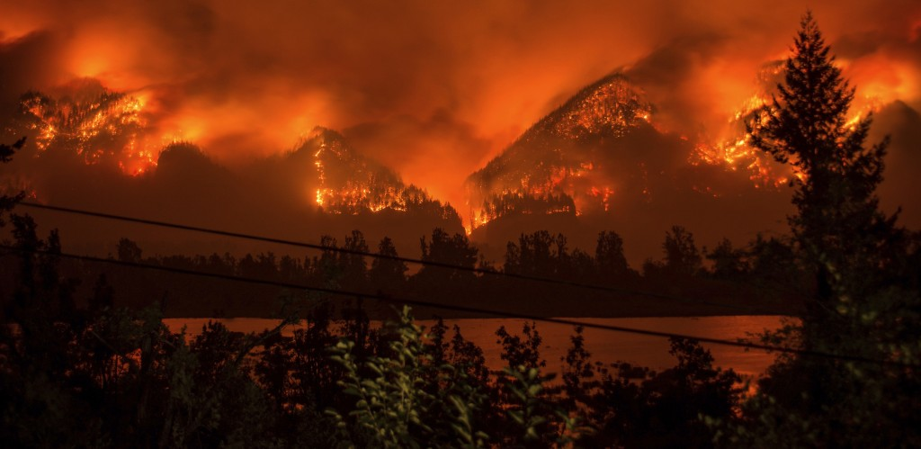 FILE - This Sept. 4, 2017 file photo provided by KATU-TV shows a wildfire seen from Stevenson, Wash., across the Columbia River, burning in the Columb...