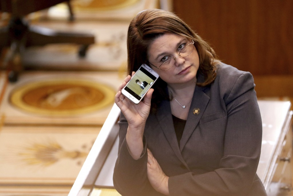FILE - In this March 3, 2016, file photo, Oregon state Sen. Sara Gelser, D-Corvallis, listens to a live stream as members of the House of Representati...