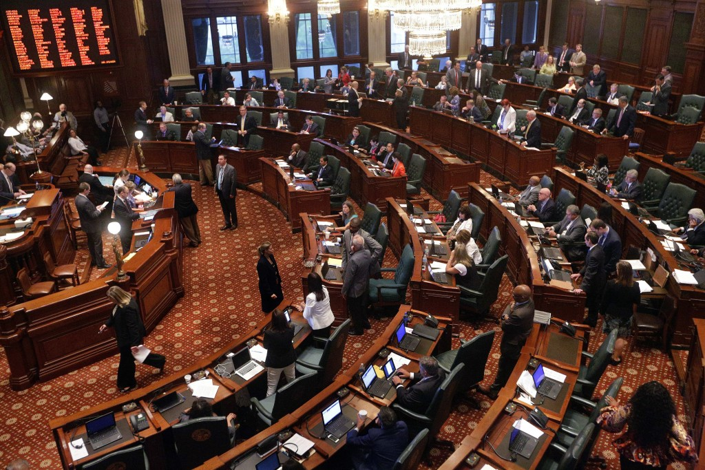 FILE - In this June 30, 2016 file photo, Illinois lawmakers debate legislation during session at the Illinois State Capitol in Springfield, Ill. An op...